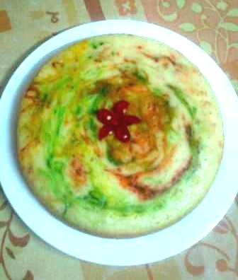 My first swirly-wirly cherry filled eggless cake with a cherry flower on top