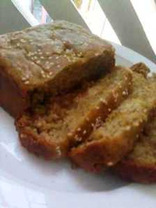 The best ever Eggless Whole Wheat Banana Bread with walnuts and cardamom sprinkled with sesame seeds on top